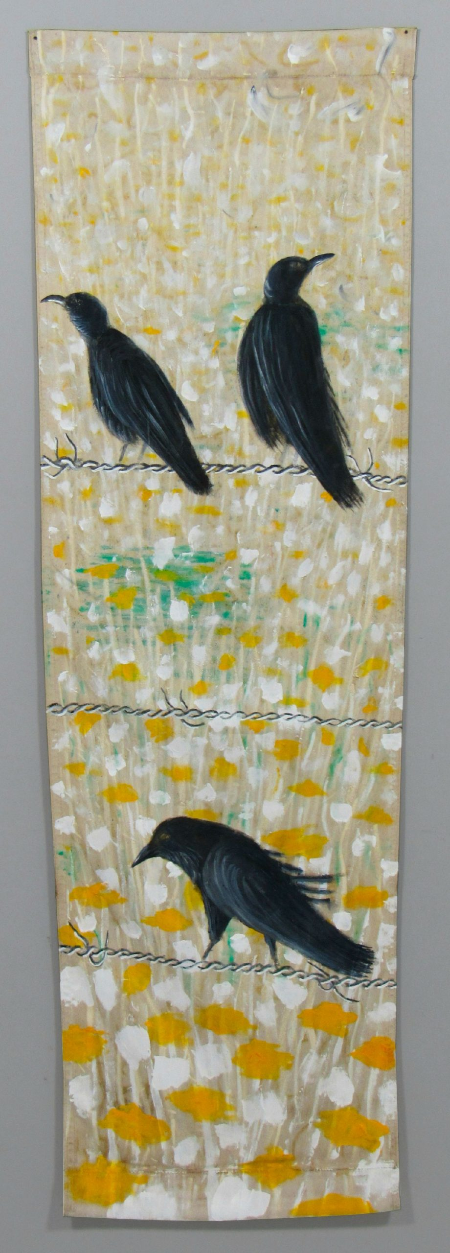 Painting birds on barbed wire by visual artist Guillermo del Valle